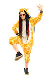 Zoo party. Rock musician in a costume of giraffe dancing and singing at studio. Zoo party. Entertainment, rock show. Isolated over white Stock Image