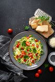 Zoodlie, healthy vegan food - zucchini noodlie with fresh green peas, tomato, bell pepper and corn for lunch. View from above royalty free stock photo