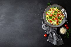Zoodlie, healthy vegan food - zucchini noodlie with fresh green peas, tomato, bell pepper and corn for lunch. View from above stock photo