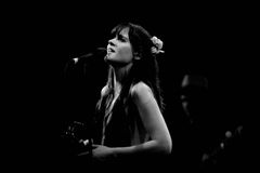 Zooey Deschanel, Hollywood Actress and singer, performs with her band She & Him at Apolo Royalty Free Stock Photo