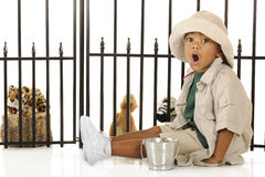 Zookeeper Roaring. An adorable preschooler roaring like the lions as he prepares to feed the animals in his pretend zoo. He's dressed in a tan safari hat, shirt royalty free stock photography