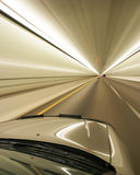 Zoom. Car zooming through a tunnel Royalty Free Stock Images