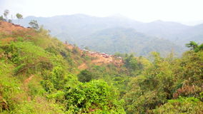 Zoom - Akha tribe village on mountain,Pongsali,Laos stock footage
