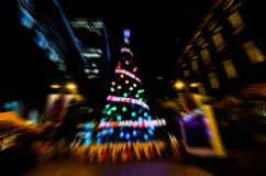 Zoom blur night photography of colorful sparkles providing a visual spectacle and light up the branches of the Christmas tree. royalty free stock image