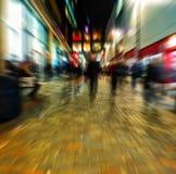 Zoom blur of pedestrian shopping street in a city center. Zoom blur abstract of pedestrian shopping street in a city center Stock Photos