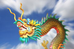 Zoom blurring china dragon statue flying in the sky. royalty free stock images