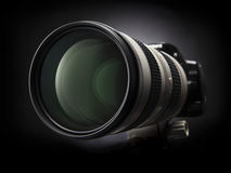 Zoom camera. Close-up of zoom lens on a dark background Stock Image