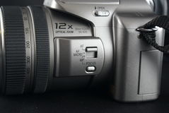 Zoom camera close up. A close up of a silver colored zoom camera Royalty Free Stock Photography