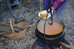 Cauldron,Caldron with hot soup on a christmas market. Zoom on a Cauldron,Caldron with hot soup on a christmas market royalty free stock photo