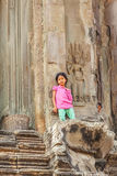 Zoom in child stand at entrance of the tower, Angkor Wat, Siem Reap, Cambodia. Royalty Free Stock Images