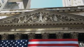 Zoom in close up shot of the exterior of the Stock Exchange. On Wall Street in New York City stock footage