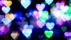 Zoom in colorful heart bokeh light. Colorful heart bokeh light background stock footage
