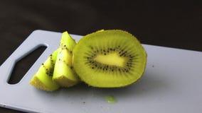 Zoom in on a cut kiwi fruit 4K stock video