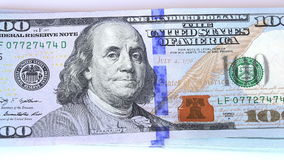 Zoom in on a 100 dollar new bills stock footage