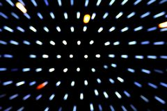 Zoom effect beam lighting bokeh movement blurred on dark black background royalty free stock image