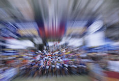 Zoom Effect Of Bicyclists. Riding in bicycle race Royalty Free Stock Photos
