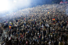 Zoom in effect on a blurred crowd Stock Photography