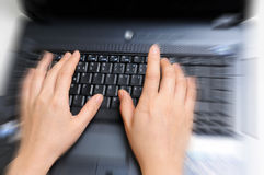 Zoom effect on female hands over keyboard Royalty Free Stock Images