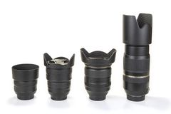 Zoom and fix lenses on camera on the white background. Zoom and fix lenses on camera on the white background Royalty Free Stock Image