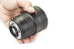 Zoom and fix lenses on camera on the white background. Zoom and fix lenses on camera on the white background Stock Image