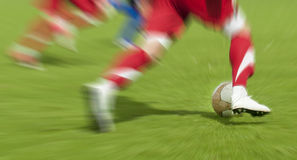 Zoom on football. Zooming on football soccer legs Royalty Free Stock Image