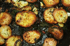 Zoom in on fried potatoes and onion. Delicious vegetables fried home made on a pan Stock Photos
