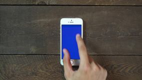 Zoom In Hand Smartphone with Blue Screen stock footage