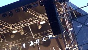 Zoom on the highest part of the platform on the stage. Concert, scaffolding.