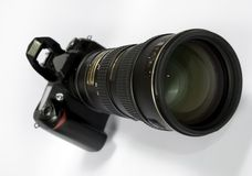 Zoom Lens. An isolated Zoom lens fitted to a SLR Camera royalty free stock photos