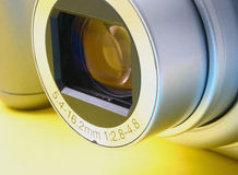 Zoom lens. Details of compact digital camera, no visible trademarks Stock Photography