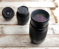 Zoom lens. Tree zoom lens on vintage wooden plank Stock Photography