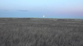 Zoom In On Moon Rise At Sunset stock video