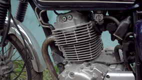 Zoom in of motorcycle engine stock footage