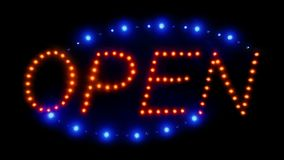 Zoom into neon open sign. Zoom into neon red and blue open sign with flashing lights stock footage
