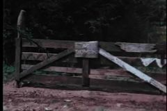 Zoom in NoTrespassing sign on wooden fence stock footage