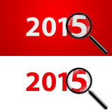 2015 with zoom. Numerals 2015 with magnifying glass in white and red stock illustration