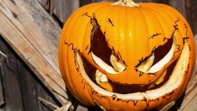 Zoom in on a Halloween pumpkin. Zoom in on a orange Halloween pumpkin stock video footage