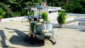 Zoom Out - American Huey Helicopter on the Roof - Independence Palace stock video