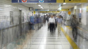 Zoom Out - Blurred Time Lapse of  Commuters at Busy Tokyo Metrorail System stock footage
