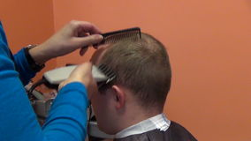 Zoom out customer man head and hairdresser make hair dress Stock Photo
