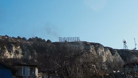 Zoom out extremely long shot ecological disaster landfill Balchik sign stock video footage