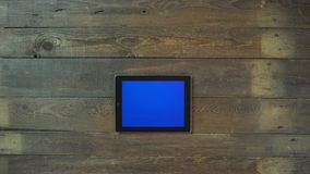 Zoom Out Hand Digital Tablet with Blue Screen Stock Image