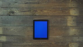 Zoom Out Hand Digital Tablet with Blue Screen Stock Photography