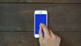 Zoom Out Hand Smartphone with Blue Screen stock video