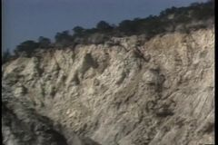 Zoom out rocky terrain stock video