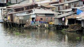 Zoom Out - Shacks on the Saigon River - Ho Chi Minh City (Saigon) stock video