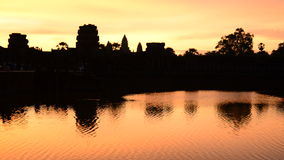 Zoom out - Silhouette of the Main Temple Buildings with Lake Reflection at Sunrise - Angkor Wat, Cambodia stock video