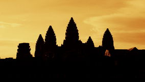 Zoom out of Silhouettes of Main Temple Spires at Sunrise - Angkor Wat, Cambodia stock footage