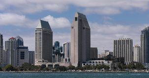 Skyline of San Diego in California. Zoom out of Skyline of San Diego in California with clouds on the sky and sunny stock video footage