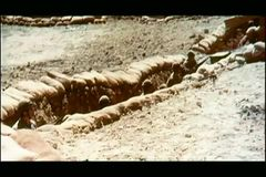 Zoom out soldiers hiding in trenches stock video footage